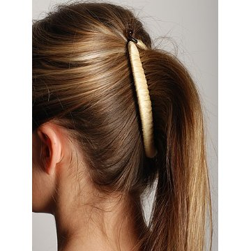 A banana clip is a  curved hair clip that has teeth and opens and closes from the top.